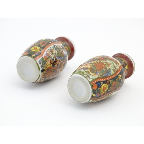 45 - Two Japanese small proportion vases with hand painted decoration depicting Geisha figures in a lands...