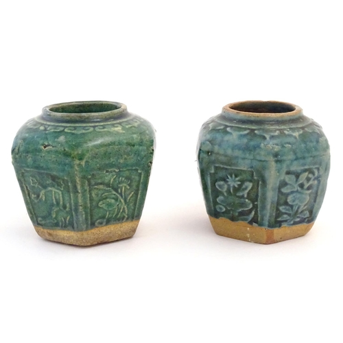 48 - Two Chinese hexagonal Shiwan ginger jars / vases with moulded floral and foliate detail with a blue ...