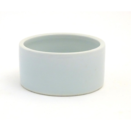 54 - A Chinese brush wash pot of circular form with a pale blue ground. Approx. 1 3/4