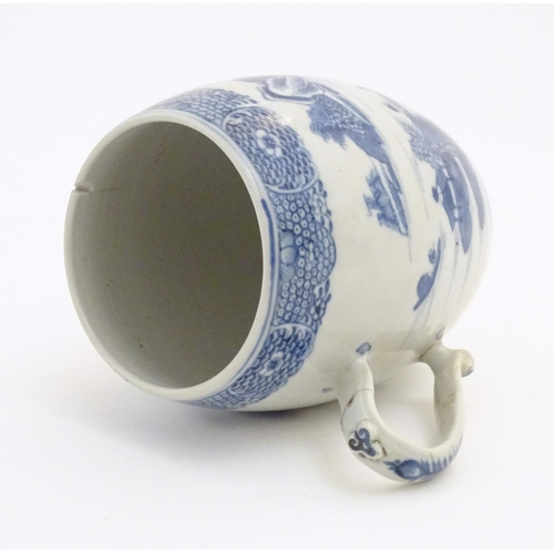 59 - A Chinese blue and white export mug of barrel form decorated with an Oriental landscape with pagodas...