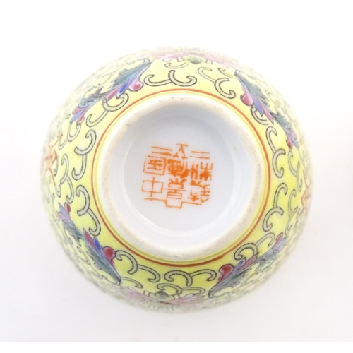 74 - A Chinese famille jaune yellow bowl of oblong form decorated with green dragons among stylised cloud...