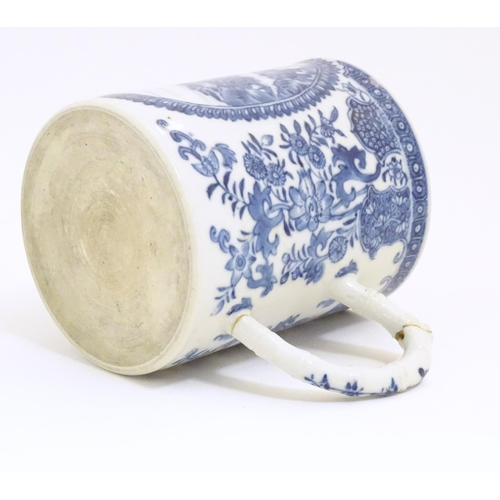 8 - A Chinese blue and white export mug depicting a landscape scene with pagodas, with floral and foliat...