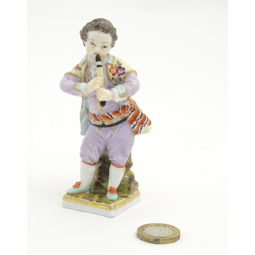 81 - A Continental figure modelled as a boy playing a musical instrument. Marked under. Approx. 4 1/4