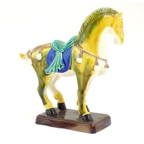 9 - A Chinese model of a Tang style horse. Approx. 5 3/4
