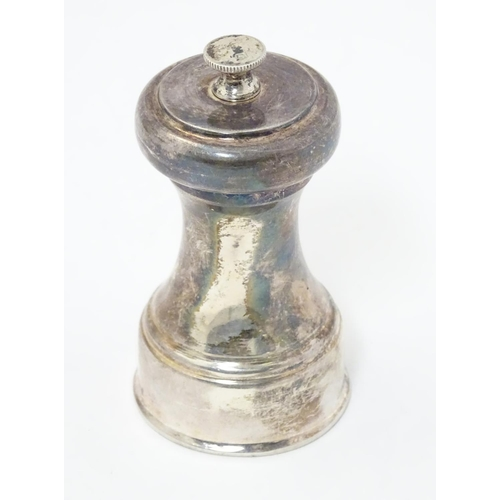 284 - A silver pepper mill / grinder, hallmarked Sheffield 1964 maker James Dixon & Sons.  3 1/2