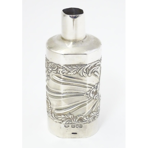 301 - A silver bottle cover with embossed detail, hallmarked London 1901 maker Goldsmiths & Silversmiths C...