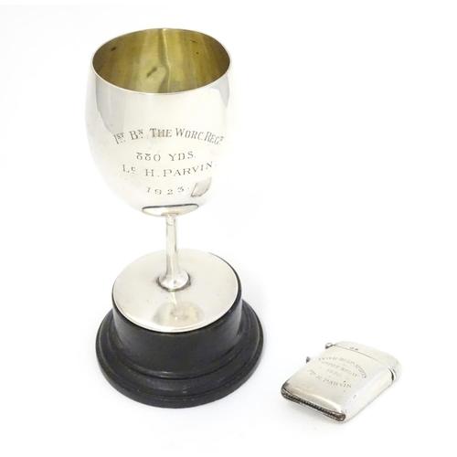 310 - A silver vesta case, hallmarked Birmingham 1919 and engraved Inter-Regimental Sports Depot Relay 192...