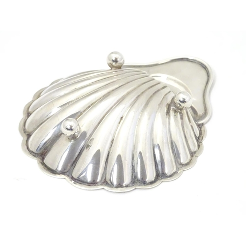 312 - A silver butter dish of shell form, hallmarked Sheffield 1901 maker  James Deakin & Sons (John & Wil...