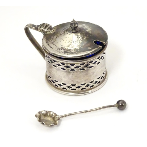 313 - A Silver mustard pot with pierced decoration, hallmarked Birmingham 1929, maker Clifford Brothers, w...