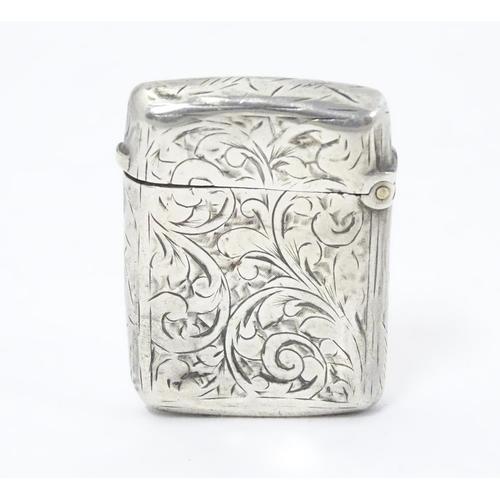 323 - A silver vesta case with engraved decoration. Hallmarked Birmingham 1896 maker JT. 1 1/2