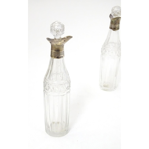 336 - A George III cruet set, the stand with engraved decoration, containing 8 cut class bottles with silv...