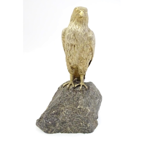 341 - A silver gilt model of a falcon bird mounted on a  granite rock formed base  Hallmarked London 1975 ...