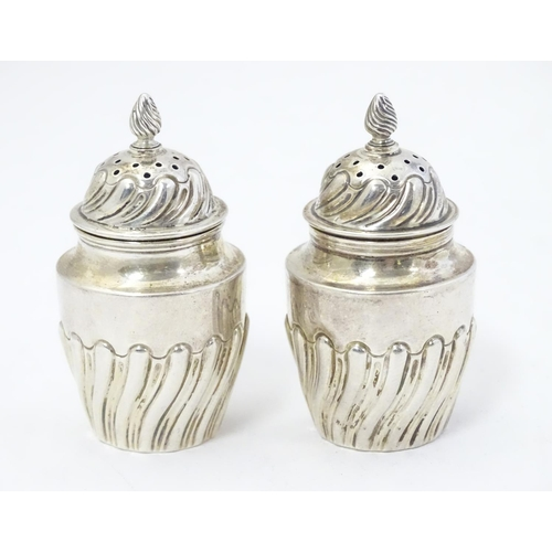 349 - A pair of Victorian silver pepperettes hallmarked Sheffield 1891 maker Harrison Brothers & Howson  2...