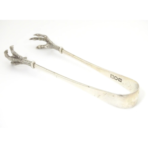 376 - Sugar tongs with birds claw grips hallmarked . London 1906 maker Robert Stebbings. Approx 5