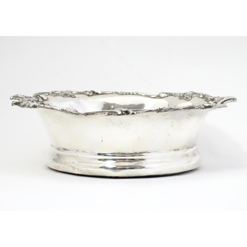 395 - A late 19thC / early 20thC  silver plate coaster with turned wooden base. 7 1/4