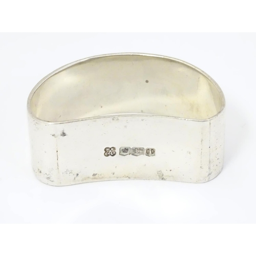 396 - A silver napkin ring of D shape hallmarked Martin Hall & Co Ltd