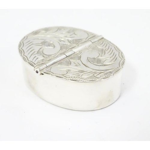 406 - A silver two sectional pill box with engraved decoration to the hinged lids. 1 3/4