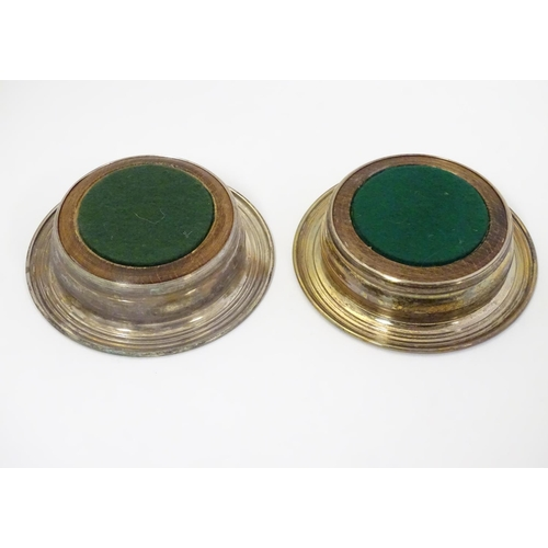 407 - A pair of silver plate small coasters with turned wooden bases 4 1/4