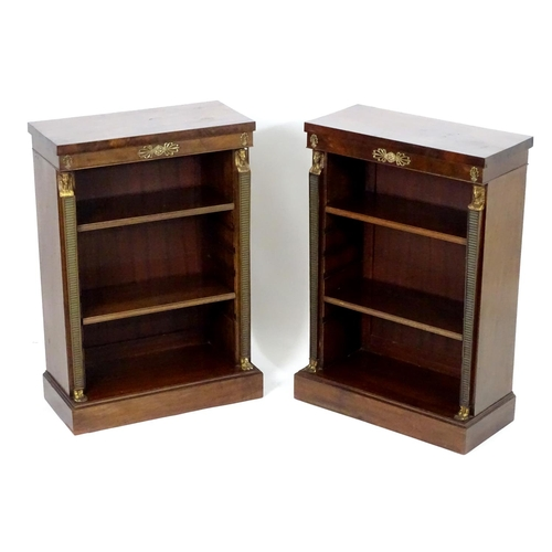 1372 - A pair of early 20thC Empire style mahogany bookcases, each having three shelves, gilt mounts and fl...