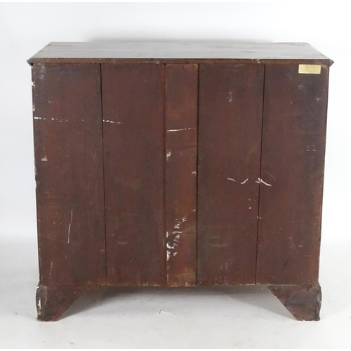 1374 - A late 18thC mahogany chest of drawers of large proportions, having a rectangular top above five sho...