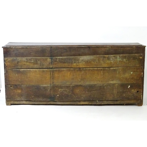 1377 - An 18thC oak dresser base with five short drawers having swan neck handles and two cupboards to the ...