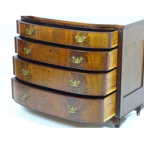1379 - A mid / late 19thC mahogany bow fronted chest of drawers, comprising four long drawers with figured ...