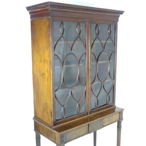 1380 - A Regency mahogany cabinet on stand, having a moulded cornice with Greek key decoration above two as...