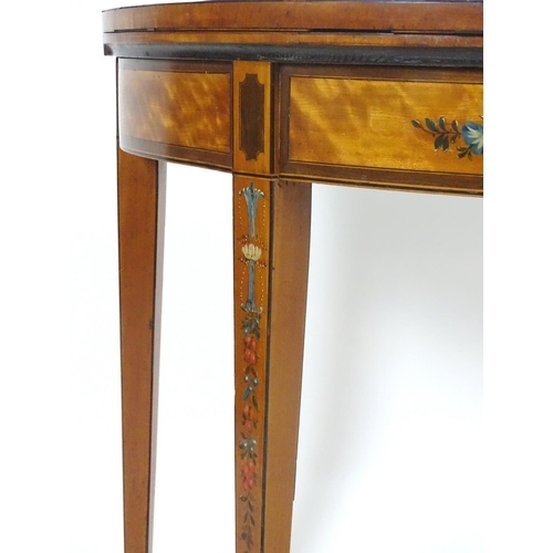 1381 - A late 18thC satinwood demi lune card table with floral painted decoration to the top, frieze and le...