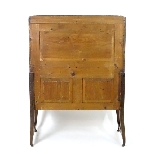 1387 - A late 19thC / early 20thC oak cabinet in the manner of Richard Riemerschmid, with a tapering upstan...