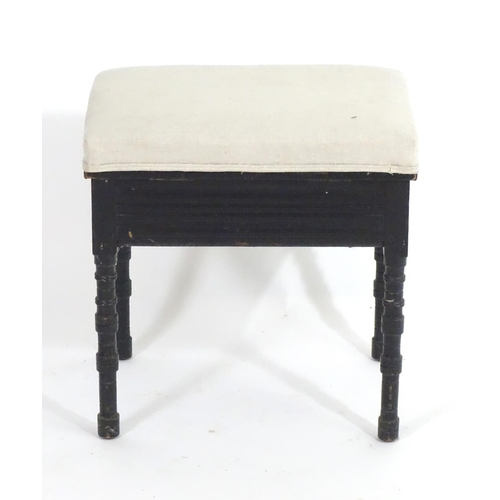 1389 - A late 19thC / early 20thC Aesthetic movement ebonised stool with a chamfered frame and ring turned ...