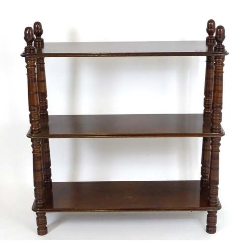 1410 - A late 19thC / early 20thC mahogany buffet with three tiers supported by ring turned tapering column...