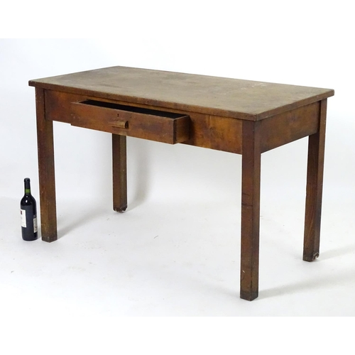 1563 - A mid 20thC fruitwood and oak desk with a rectangular top above a single short drawers and raised on...