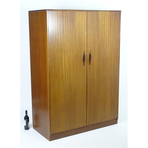 1564 - Vintage retro, mid-century: an afrormosia double wardrobe by Elliotts of Newbury, 48