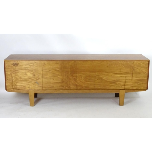1565 - Vintage retro, mid-century: a large c1970 teak sideboard, in the Danish style, the three compartment...