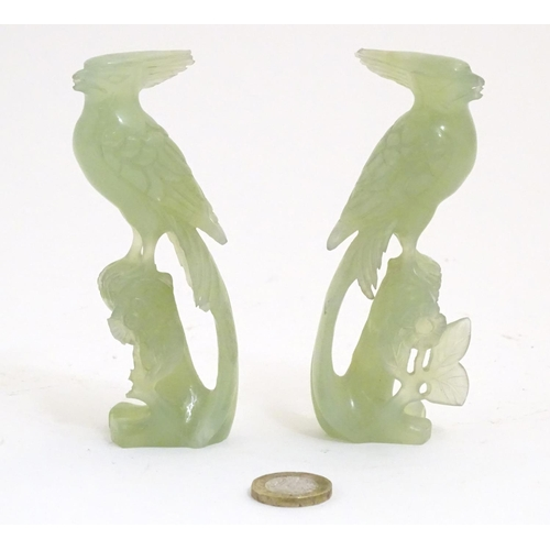 1002 - A pair of Oriental carved jade / hardstone models of birds among foliate. Approx. 4 3/4