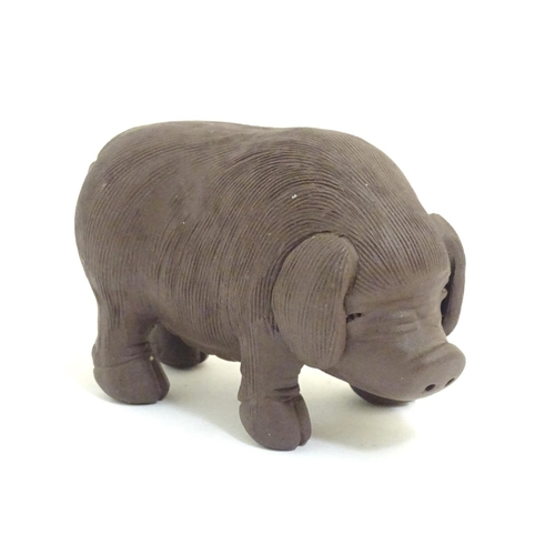 1020 - A Chinese Yixing clay model of a pig / boar with impressed character marks under. Approx. 2 1/4