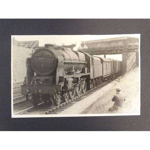807 - Railway Interest: An early 1950s photograph album containing monochrome photographs of steam trains,...