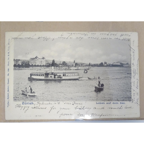 828 - A 20thC postcard album with a variety of postcards to include commemorative postcards depicting Edwa...