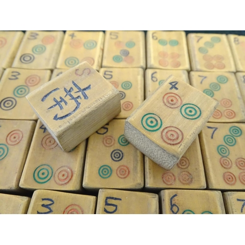 860 - Toys: 20thC bamboo Mahjong tiles. Together with some bone gaming counters. The mahjong box approx. 3...
