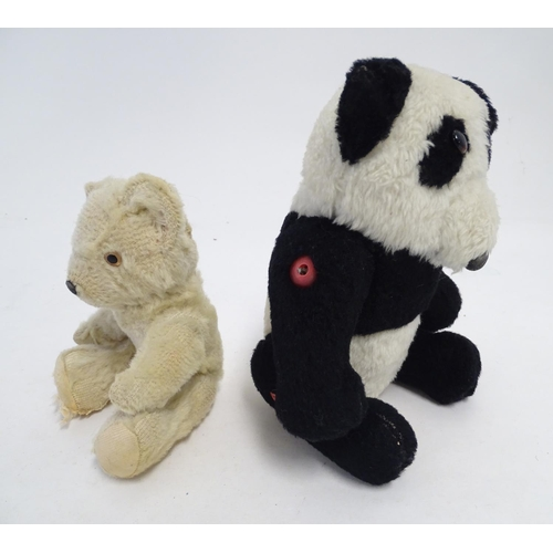866A - Toys: Two 20thC bears, comprising a panda bear with button jointed limbs, and a straw filled teddy b...