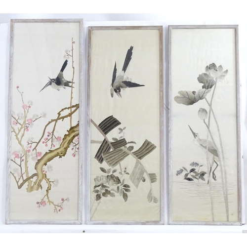 1360 - Three 20thC Chinese embroideries, comprising a bird in flight above branches of blossom, a crane in ...