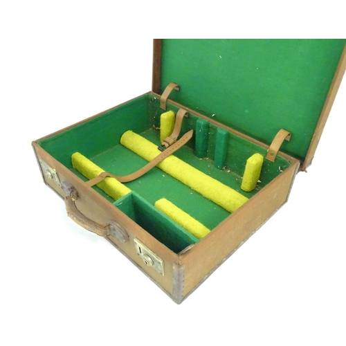 1246 - A mid-20thC canvas and leather instrument case, with green baize lining, 20