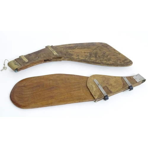 1248 - Two early 20thC hardwood boat rudders, with brass fitments, the largest approximately 36