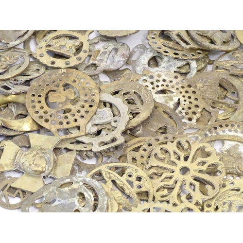 1291 - A large quantity of Victorian and later horse brasses to include portraits, animals, sunbursts, etc....