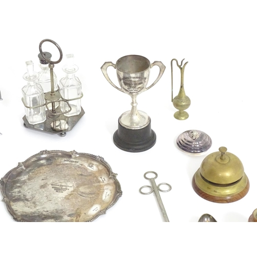 1298 - A quantity of assorted brass and silver plate items to include, trophy cups, salvers, cruets, trivet...