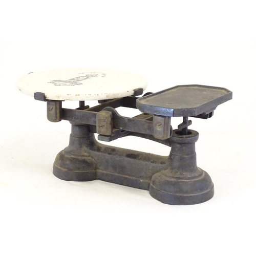 1301 - Victorian cast iron scales with 7 brass weights and a ceramic plate depicting the figure of Justice ...