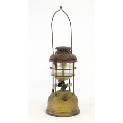 1310 - A mid-20thC Tilley lamp, of brass construction  with swing handle, 13 1/4