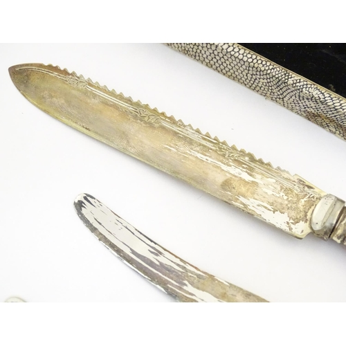 1320 - A mid 20thC cased set of 6 tea knives, with a  preserve spoon, butter knife and small cake knife all...