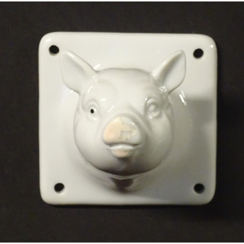 1327 - A ceramic novelty coat hook formed as a pigs head. Approx 3
