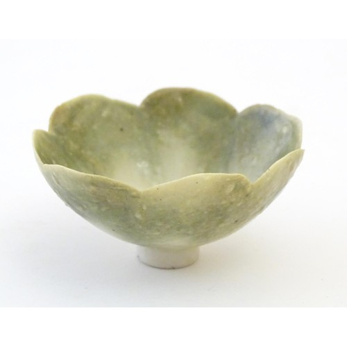 150 - An Arts & Crafts miniature footed bowl formed as a flower with petal detail. Marked with monogram un...